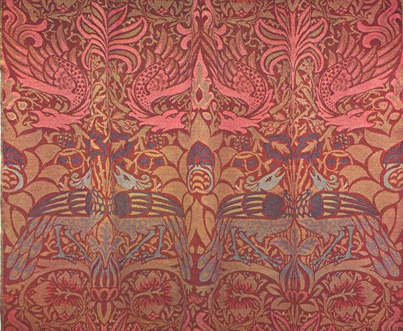 """Peacock and Dragon"" woven wool fabric. Designed by William Morris in 1878. Produced both at Queen Square and later at Merton Abbey The design was used for wall hangings; came in different colourways."