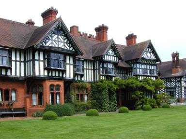 The garden front of Wightwick Manor. It was designed purposely in a medieval-revival style of architecture, incorporating extensive Tudor-revival elements.